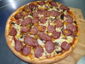 Raging Bull Pizza - homemade pizza sauce, mozzarella, smoked beef salami, mushrooms, onion, fresh chilli